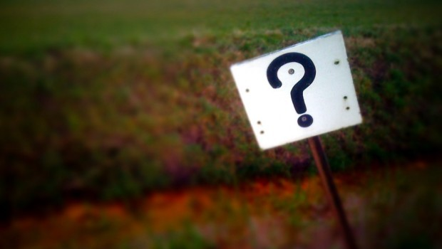 Question Mark Sign at Farm Field