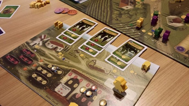 Players plant vines, crush grape and bottle wine on the player board