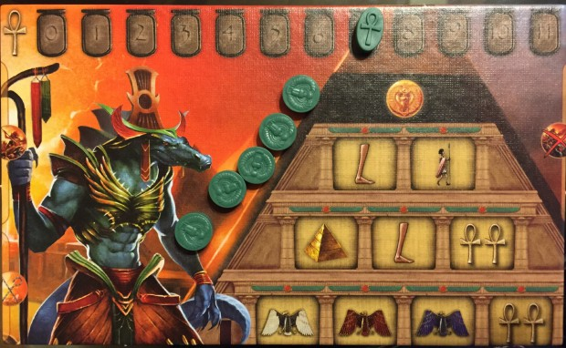 Player board with five action tokens. Those ankhs up there are Prayer Points—money, remember?