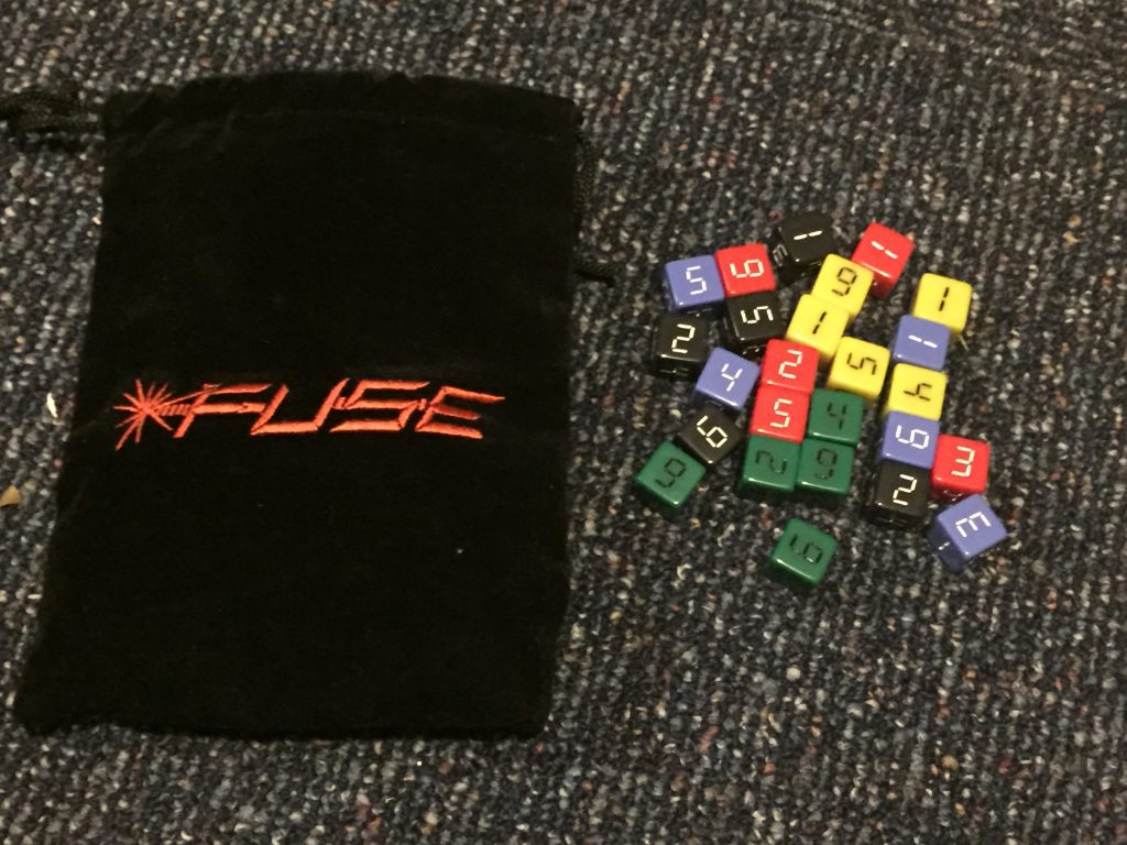 The instruments of your success or failure, along with the included plush dice bag.