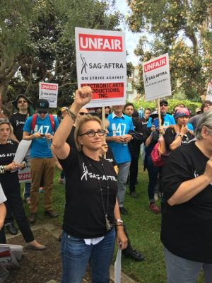 SAG-AFTRA President Gabrielle Carteris chants in solidarity during the picket, which drew more than 300 supporters to EA's LA headquarters.