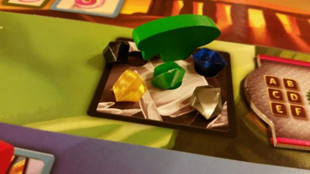 Mysterious crystals are central to the game's theme and play, but it's prestige that wins you the game.