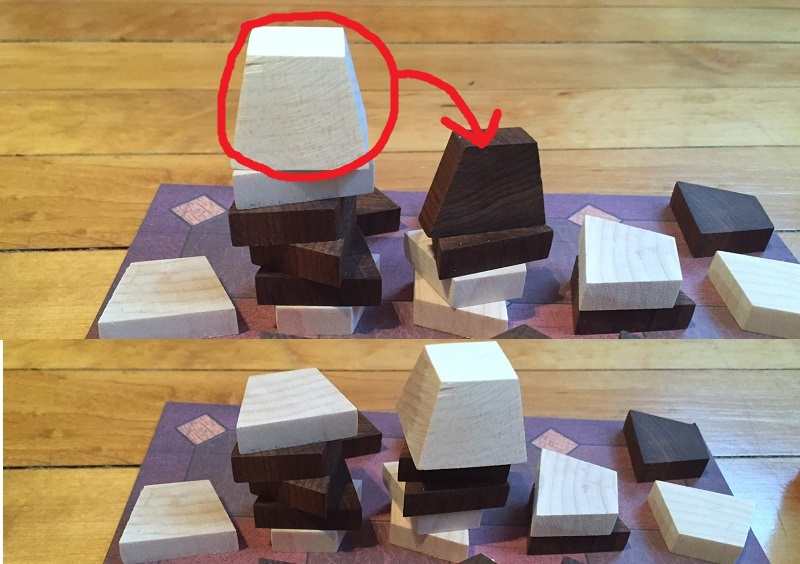 A white capstone can flatten the standing black piece and complete a game-winning road for the white player.